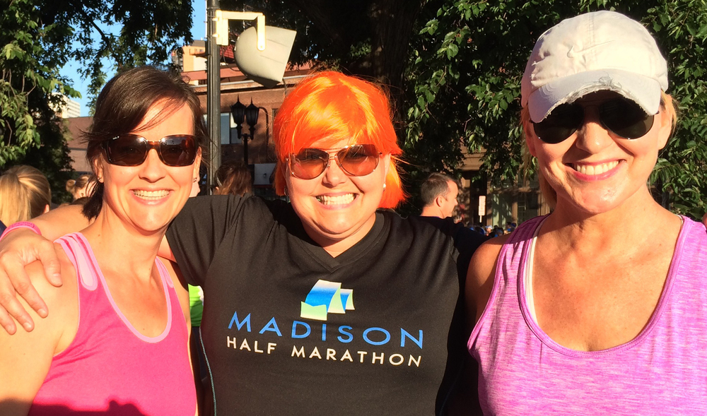 Jen Johnson sports her Madison Half Marathon T-shirt with friends Kris and Stef at the Torchlight 5k in Minneapolis. The photo was taken by Jen's husband Eric Johnson in July 2014, two months after Jen's bilateral mastectomy.