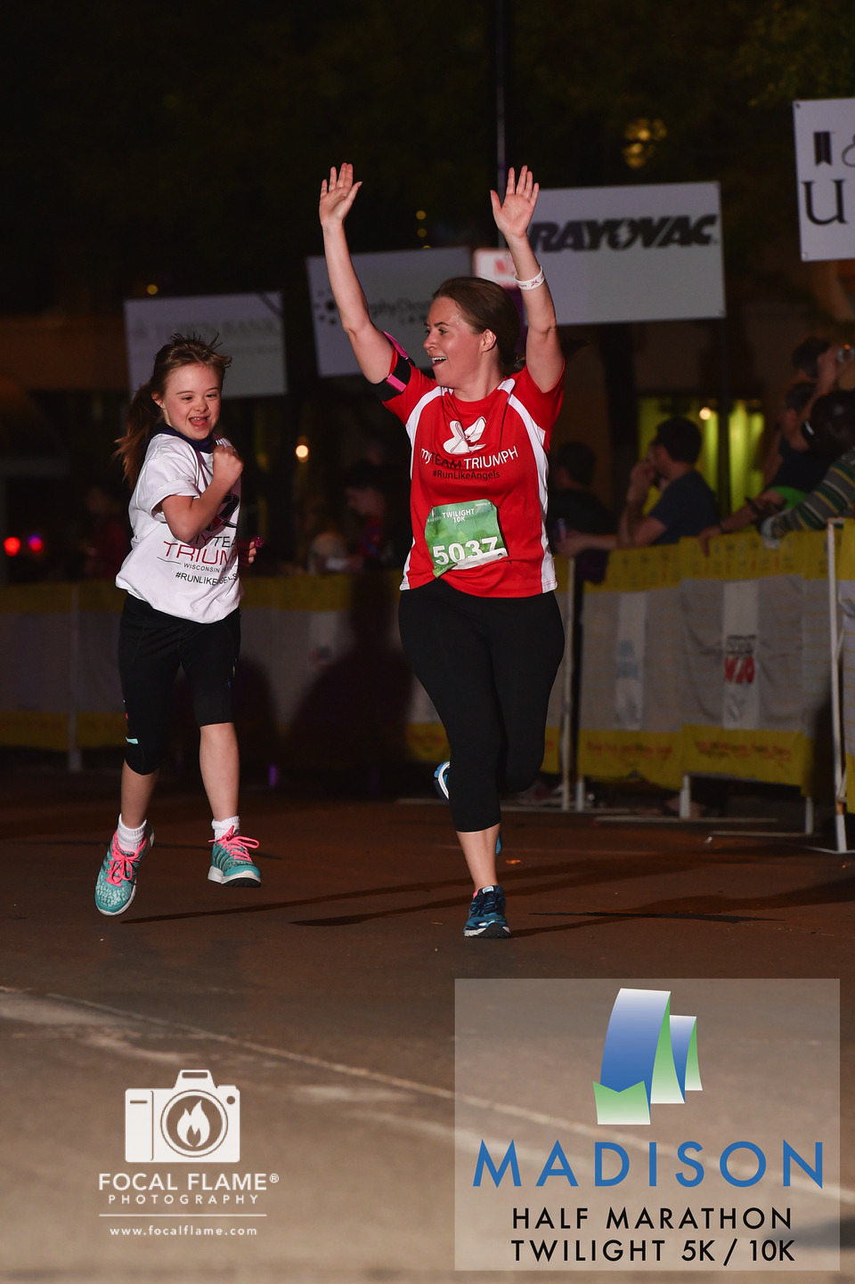 This photo of Abbey finishing the Twilight 10K in May 2015 recently appeared in New York City as part of the National Down Syndrome Society's Times Square Video presentation—an annual photo showcase of the amazing contributions and achievements of people with Down syndrome. © 2015 Focal Flame Photography | Photo credit: Clint Thayer