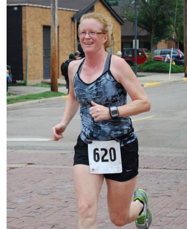 Carolyn looks forward to competing in her first-ever Madison Marathon on November 8, running as a guide alongside her running partner. Photo credit: Adam Kissinger
