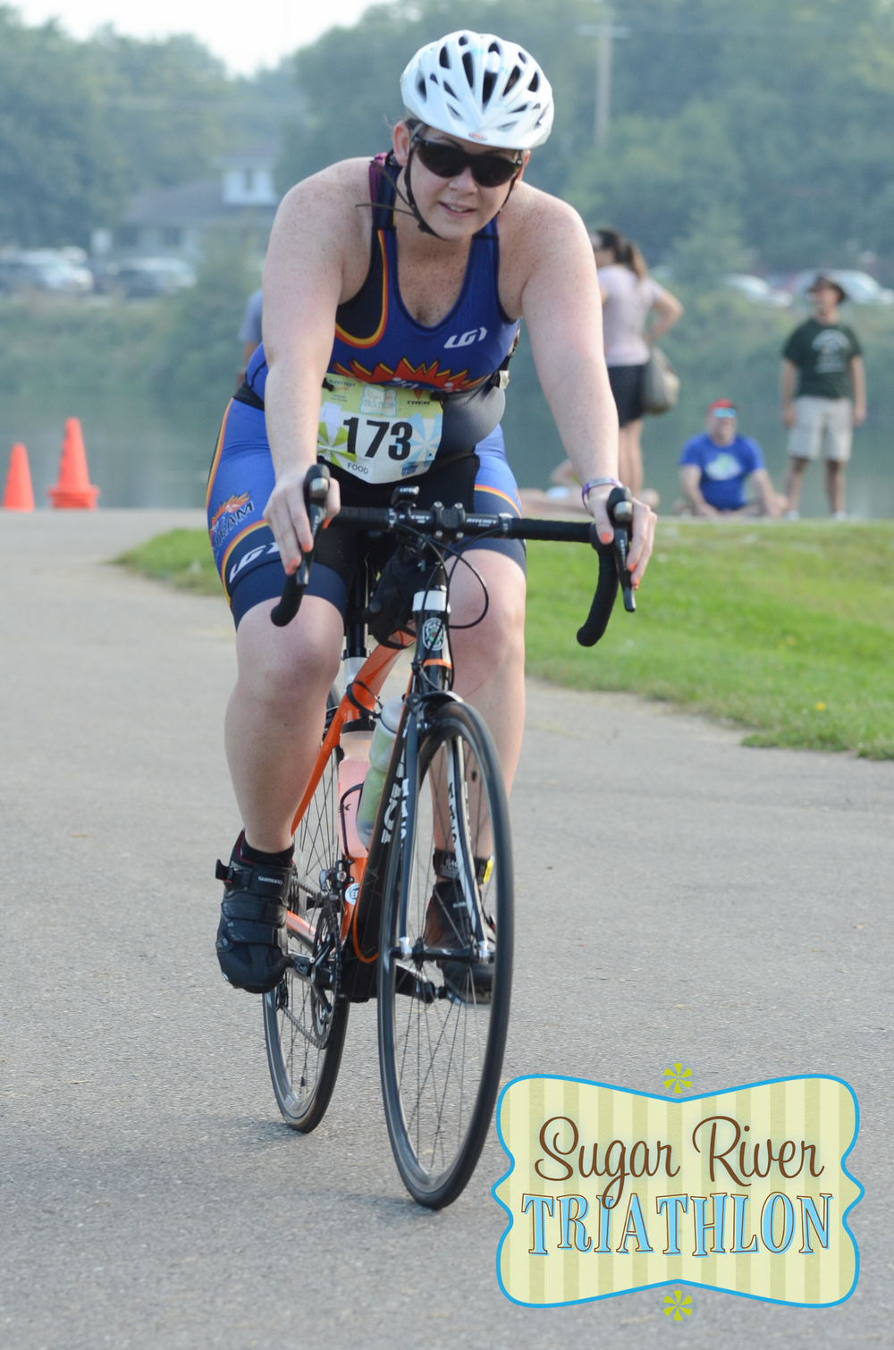 Bridget on the bike at the Sugar River Triathlon. (c) 2015 Focal Flame Photography | Photo credit: Mark Olson on behalf of Focal Flame Photography