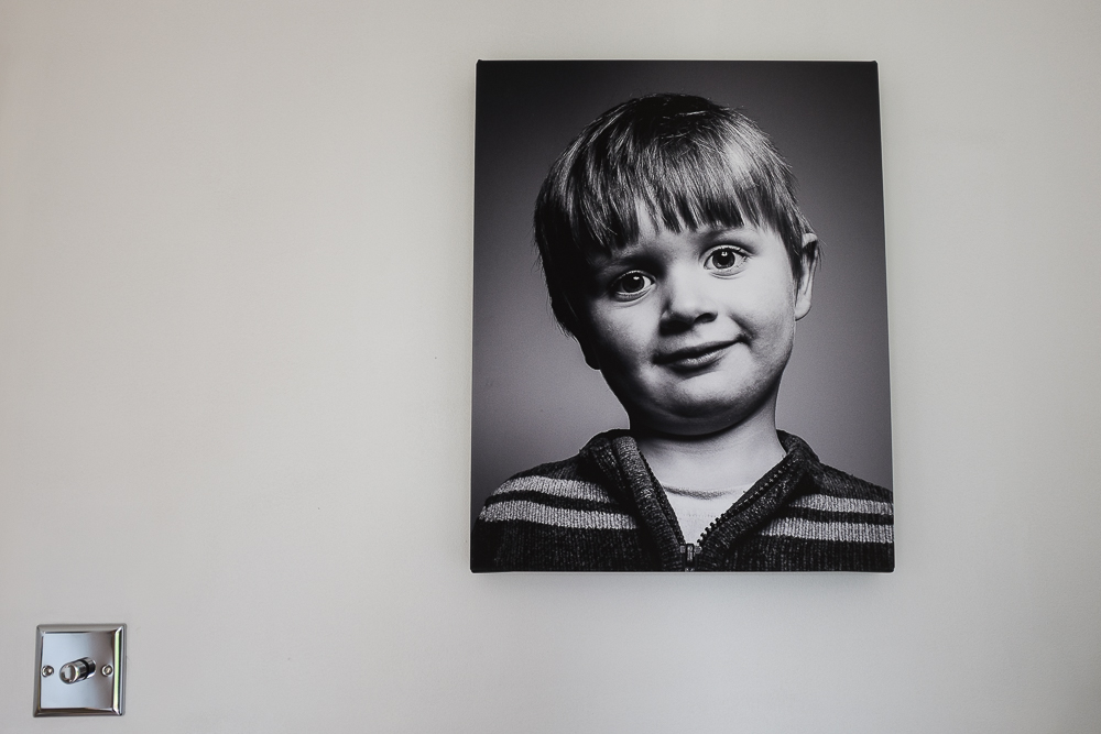 """The size of this one is 16"""" x 20"""". It's big enough for this wall and for this particular photo, but would probably look a little small on a big wall or with an environmental portrait showing other details."""