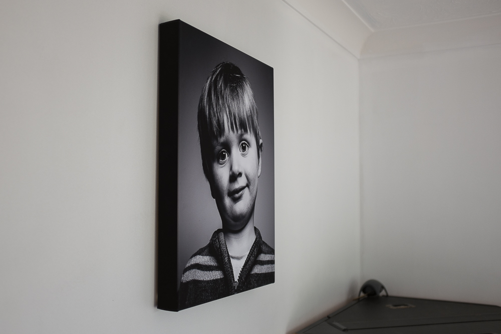 I chose to have the black edging on this canvas because it would have cropped the photo too much to have the image wrap around the canvas frame. The frame hangs flush with the wall and came with all fixtures attached ready for hanging.