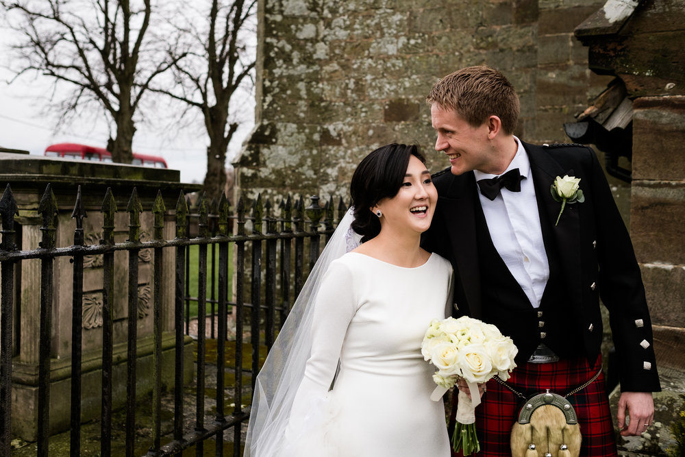 English Winter Wedding Photography at Somerford Hall, Staffordshire Red Bus Double Decker Kilts Bagpiper-33.jpg