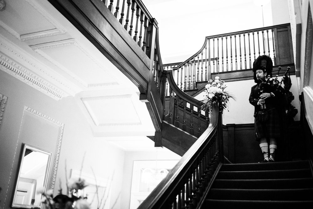 English Winter Wedding Photography at Somerford Hall, Staffordshire Red Bus Double Decker Kilts Bagpiper-43.jpg