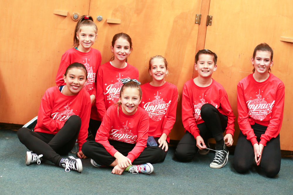 Impact Dance Center students waiting backstage for their performance