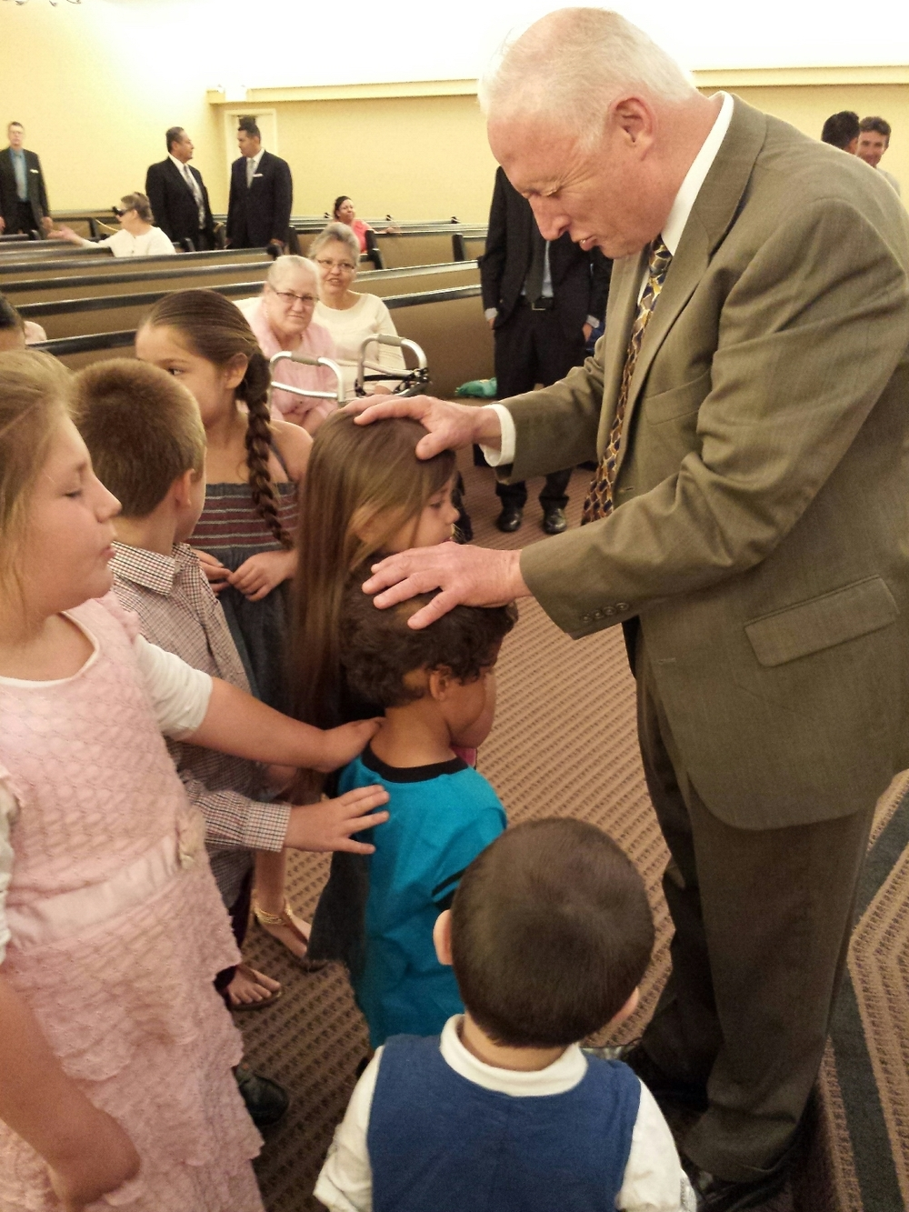 Pastor praying for the kids.
