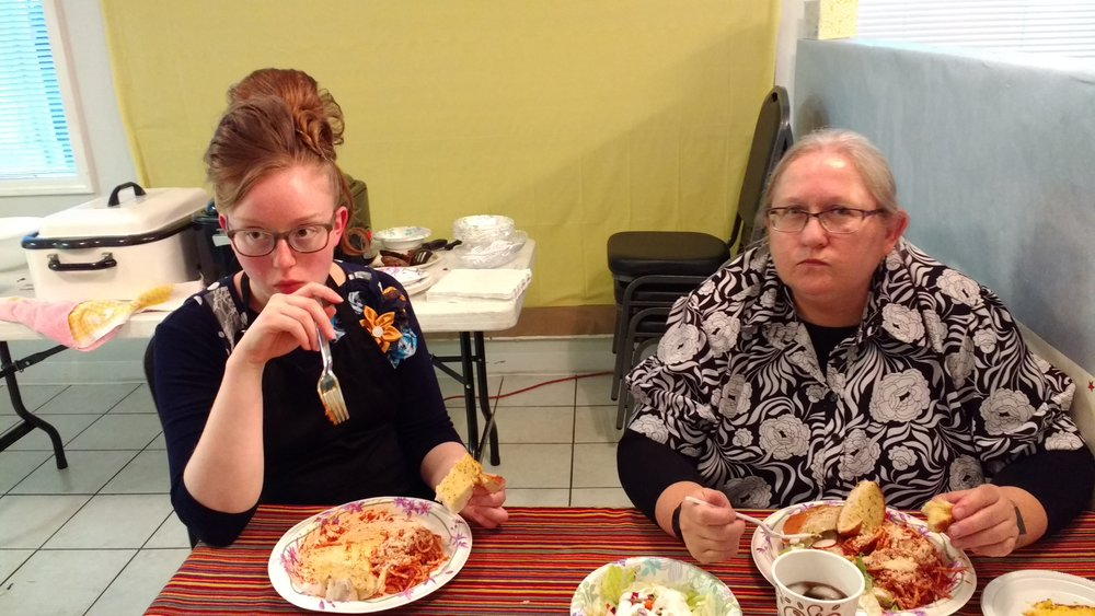 Sis. Sarah and Sis. Debbie Ann - workers relegated to eating in the kitchen since there was no room in the Fellowship Hall to sit and eat. Praise God!