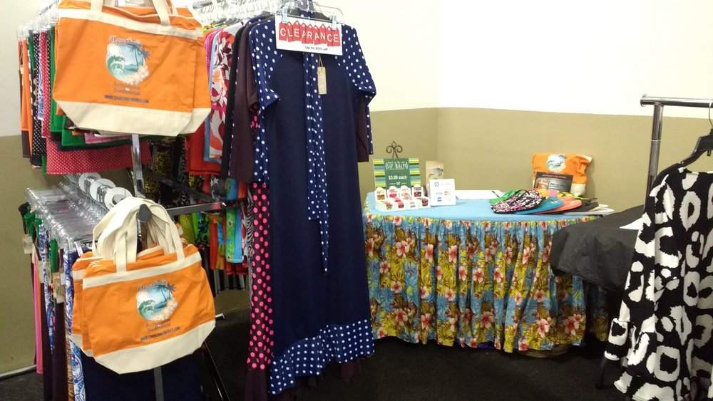 Apostolic Bathing Suits, beach bags, booth area