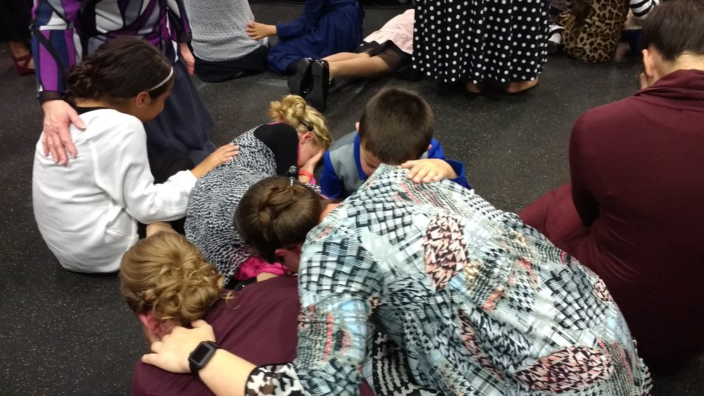 Sis. Jennifer, Chloe and little Jared praying for his Mommy