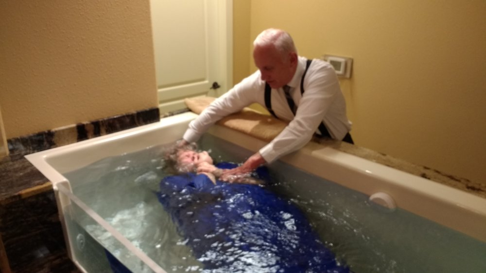 Beth being baptized in the name of Jesus