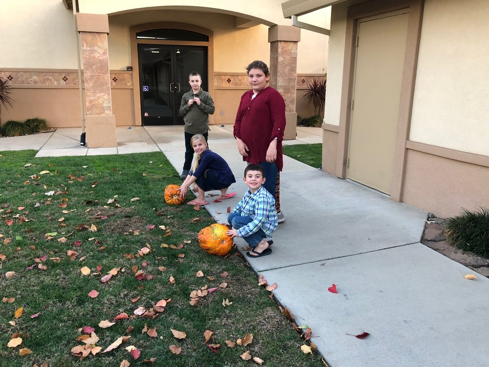 Dallas, Mandy, Fantasia and Jared, getting ready for the pumpkin rolling contest.