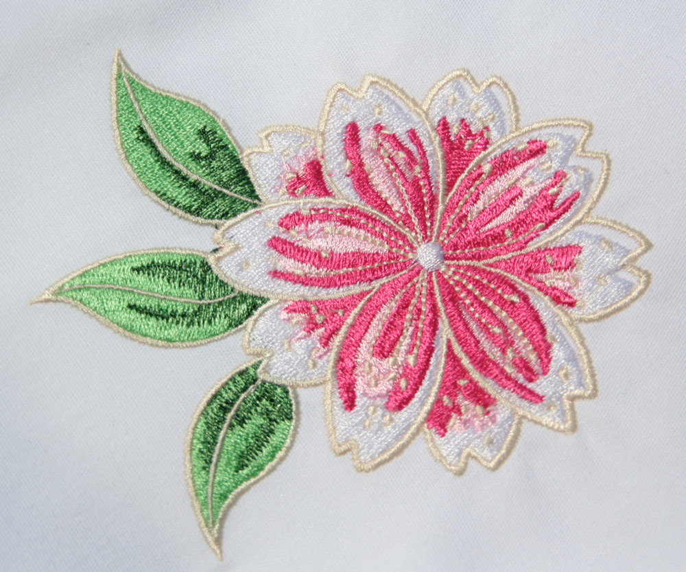 "Original embroidery embellishment by Nancy Sandreuter, image taken from Latanision's watercolor painting ""Akiko"", used to make blended image for Art & Embellishment exhibit."