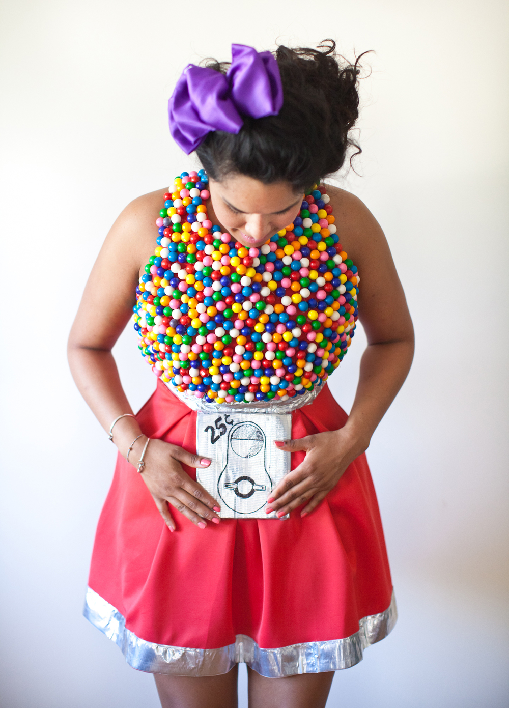 Thanks to my lovely sister here's a tutorial on how to make your very own gumball machine costume!     -   Duck Tape      -  1 black sharpie pen      -  2 to 3 bags of machine size gumballs      -5.5 x 6.5 inch cardboard piece     - Red Dress     - Hot glue gun