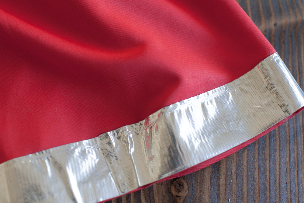 Line the bottom and waist of your dress with duck tape. Cut 4 to 5 inch pieces to line everything perfectly.