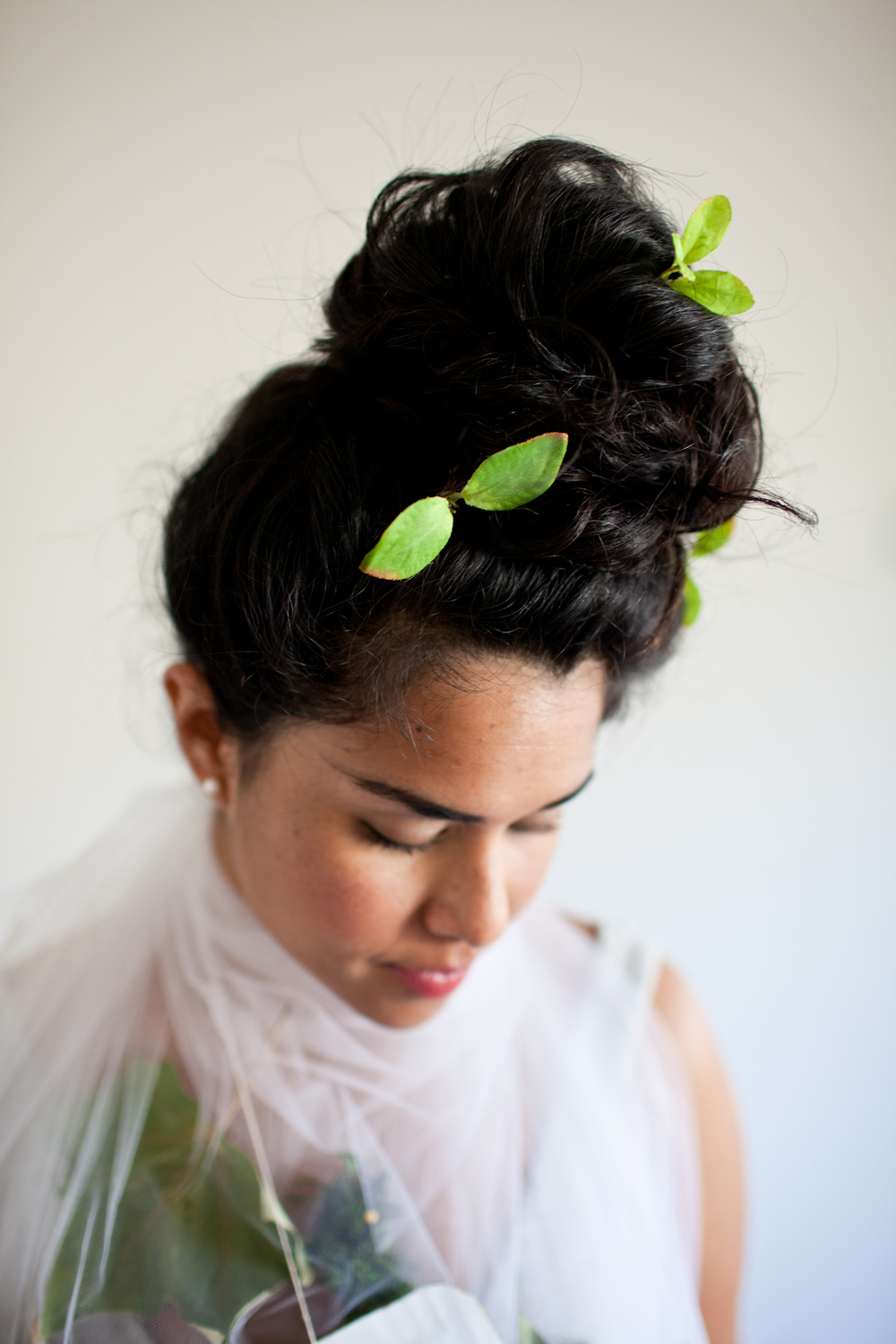 I placed cute little leaves in my hair! A green bow would look great as well!!!