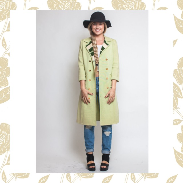 Green military coat found in our vintage shop, check it out here!