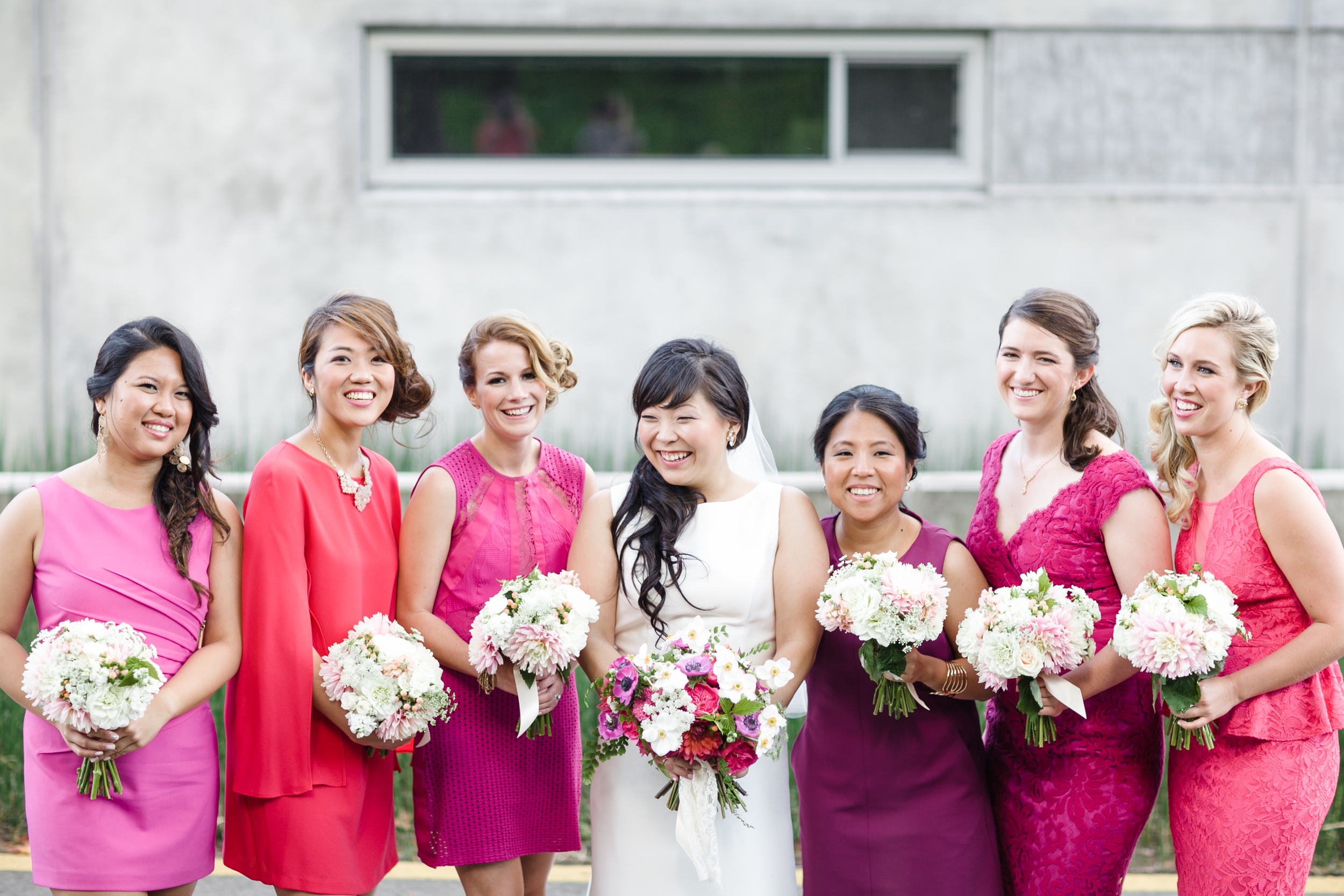 The bridesmaid dresses were perfect! Their light blush and white bouquets popped off the dresses