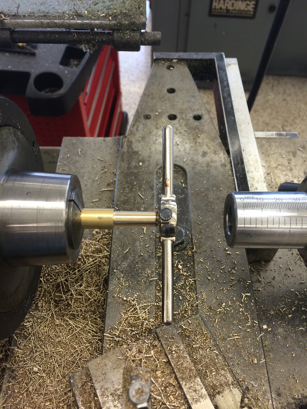 Tapping the shank with a 10-24 die. I used the tailstock to keep the die straight.
