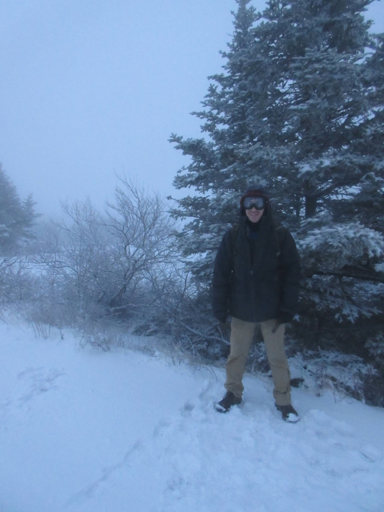 At the summit of Cadillac Mountain. There was not much to see due to the front passing through at the time.