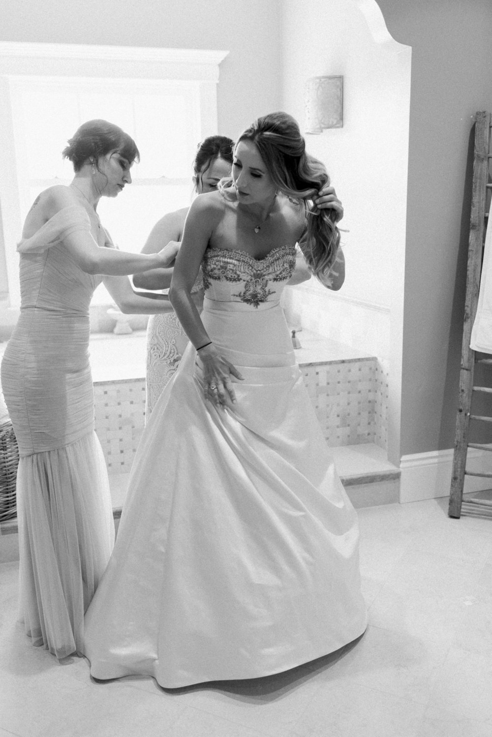 bride-getting-into-her-wedding-gown.jpg
