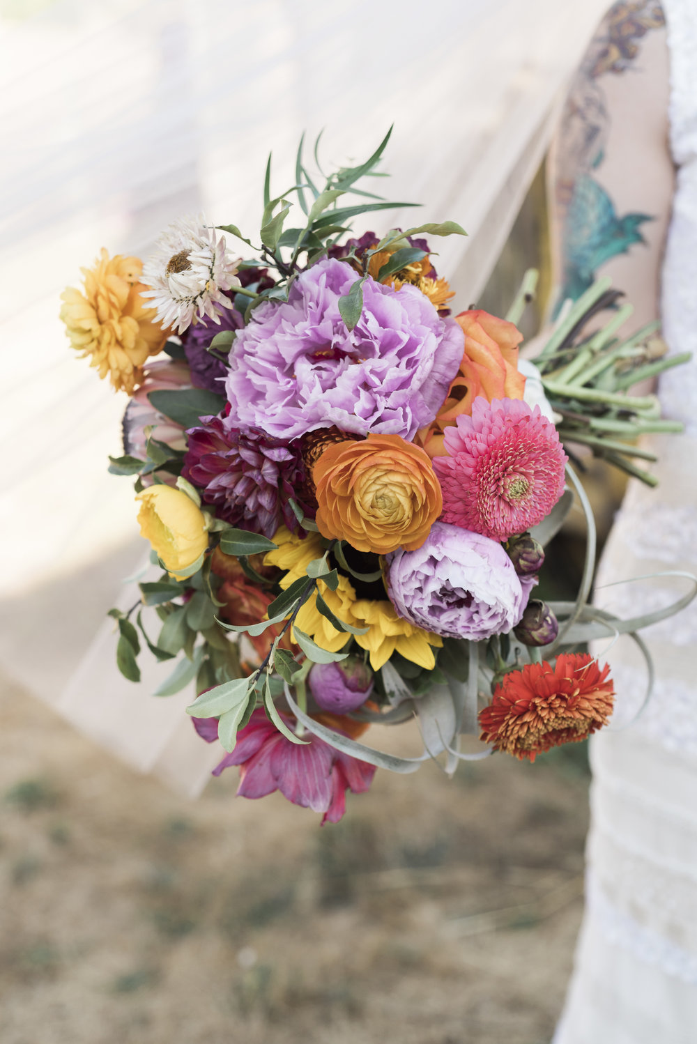 bride-holding-colorful-bouquet.jpg