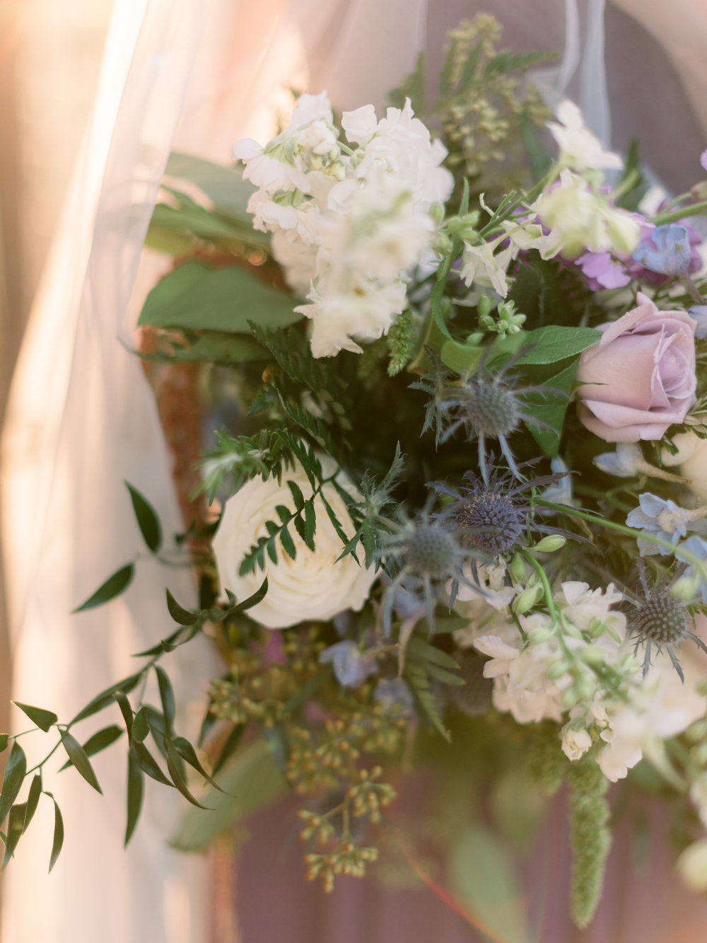 bridal-bouquet-with-lavender-roses-and-blue-thistle.jpg