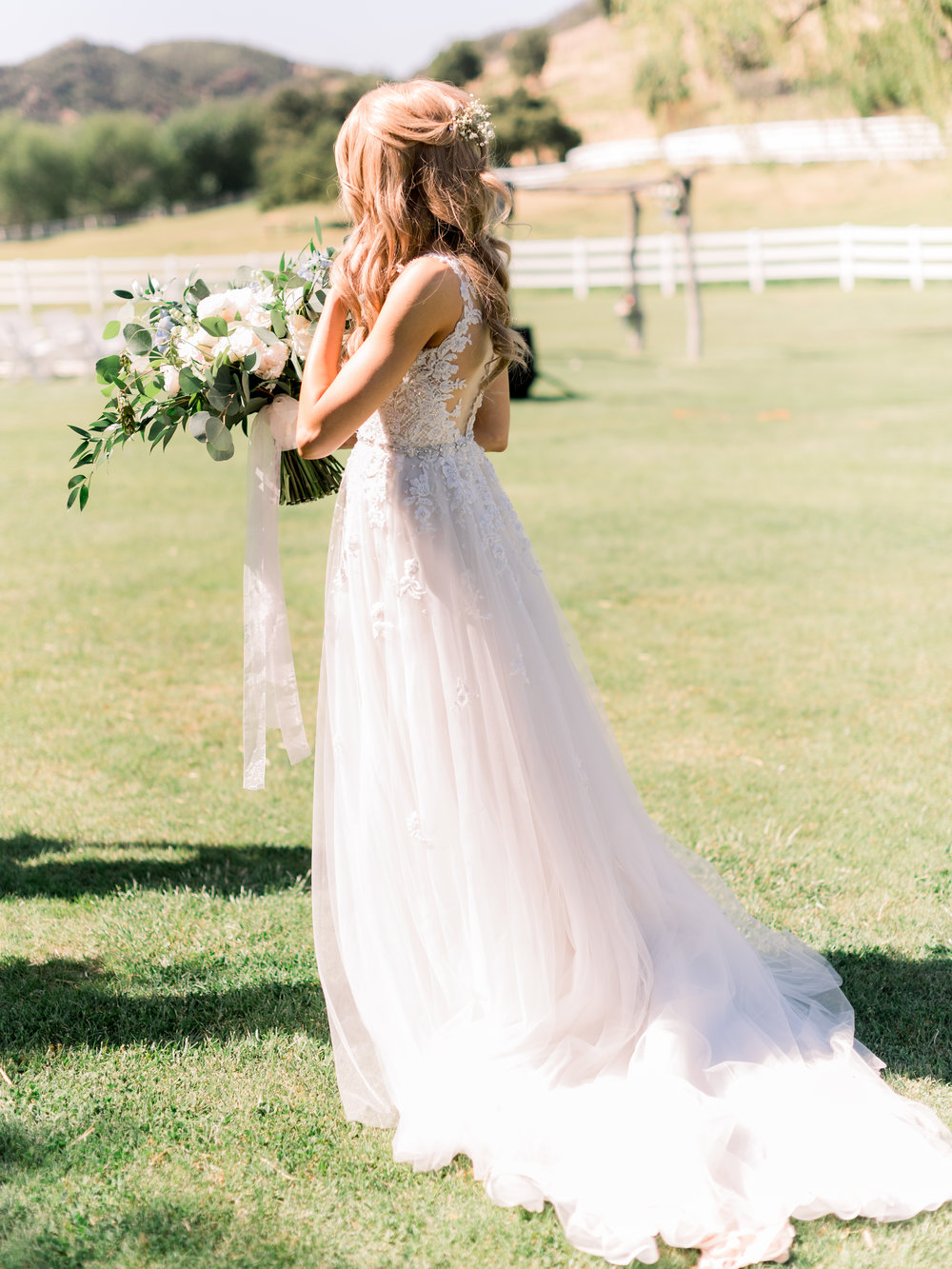 bride-walking-through-the-grass.jpg
