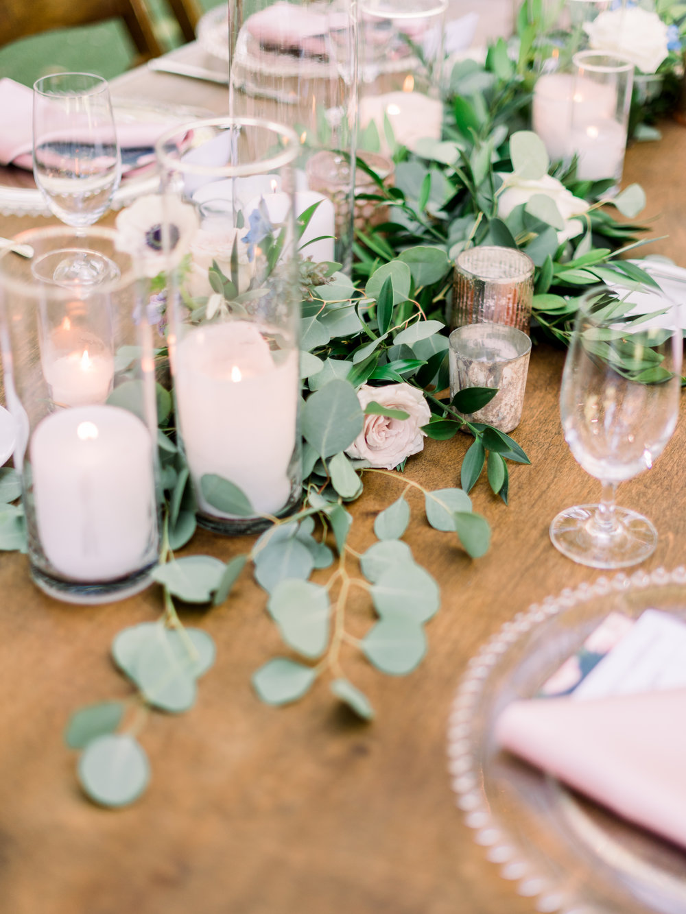 wedding-table-arrangement-with-floral-garland.jpg
