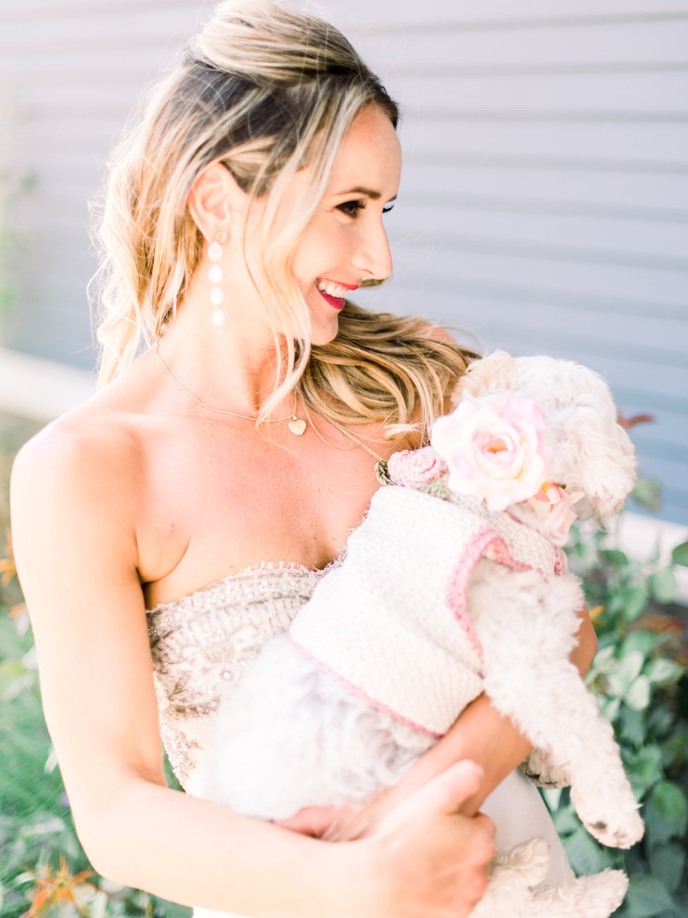 happy-bride-holding-her-puppy.jpg
