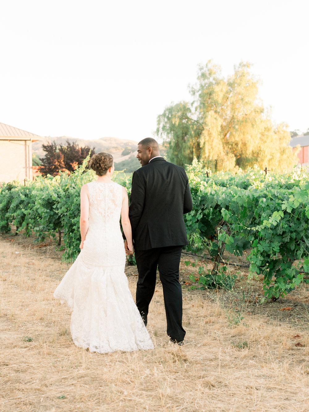 bride-and-groom-walking-through-the-vineyard.jpg