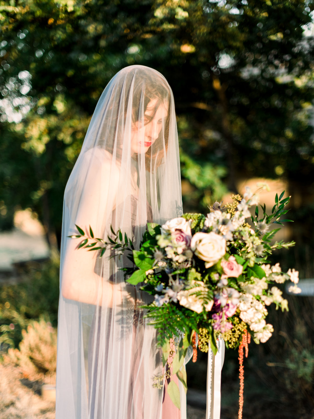 veiled-bride-holding-a-bouquet.jpg