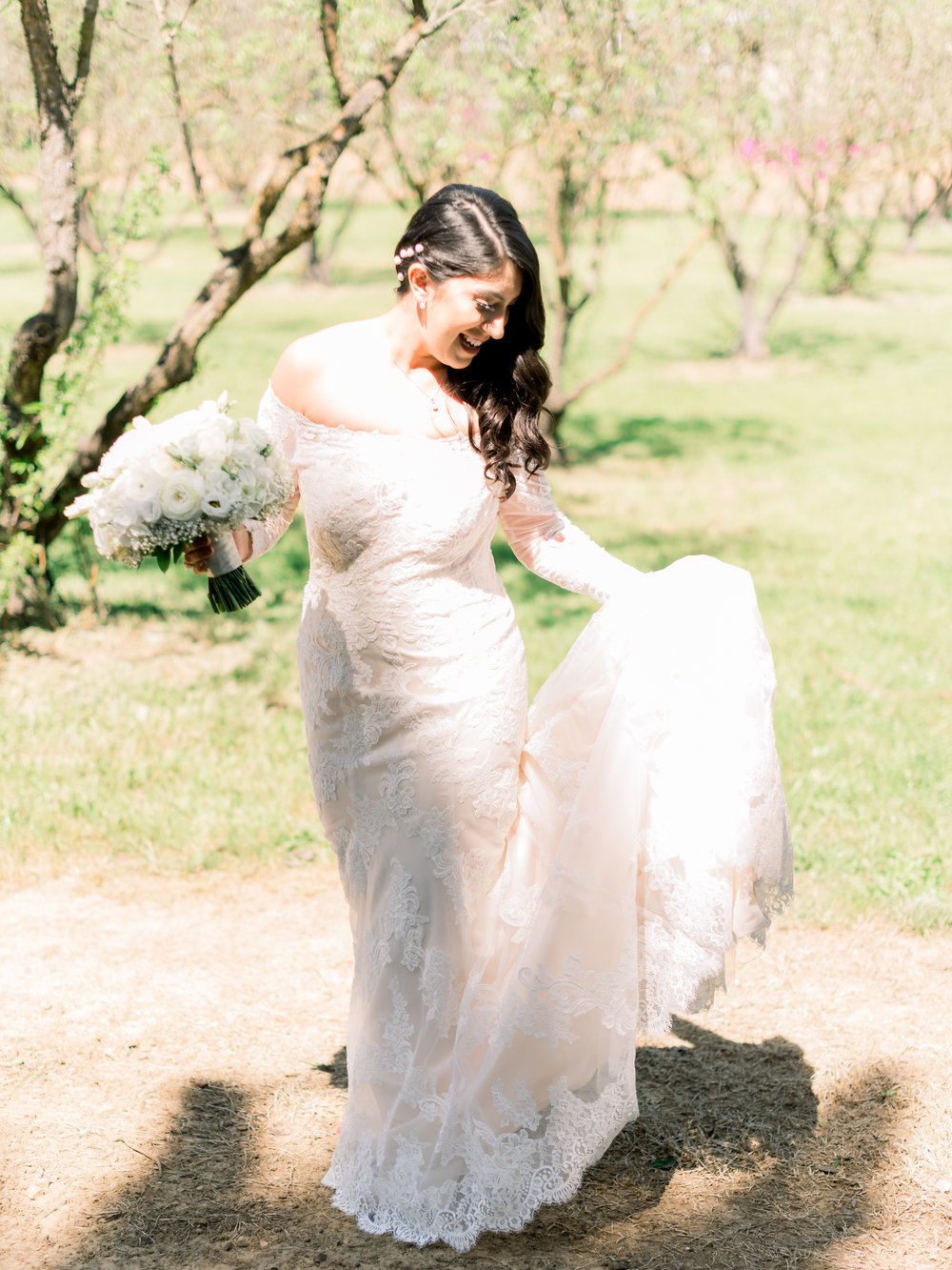 the-bride-being-playful-in-the-vineyard.jpg