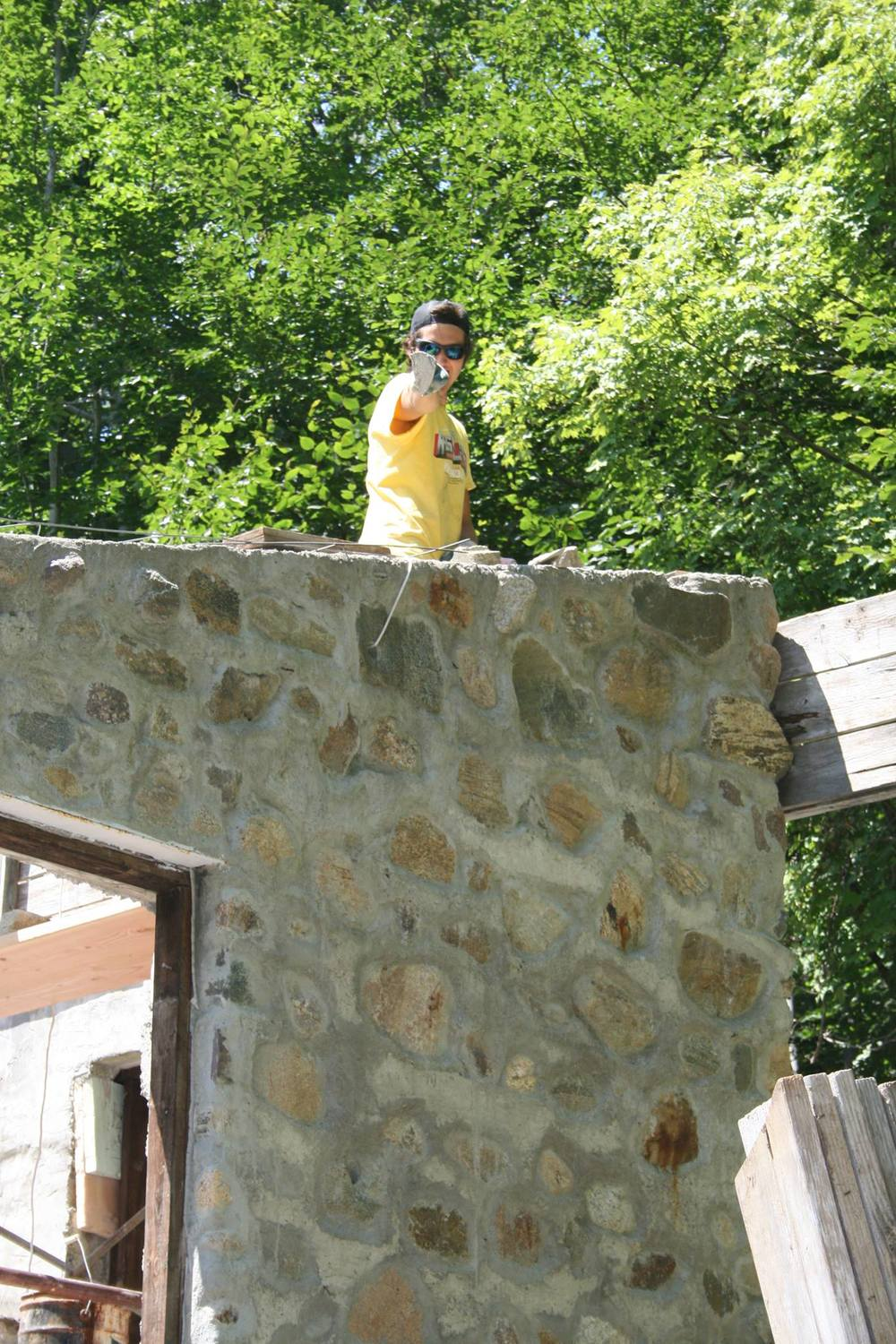 Ben Lillibridge builds the back wall.  Photo by Nancy Candea.