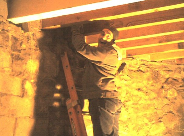 Jeff Bender removes formwork from living room roof beam pockets.