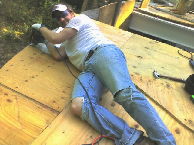 Jon Barker trims the living room roof deck.