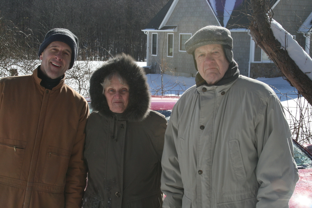 JIm Reilly with parents June and Don Reilly. They sealed beams, shoveled snow, and provided endless support.