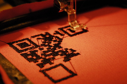 More robots! On this Embroidering Robot, we can whip out a design for you, in multiple colors, in just a short while.  We're still in the exploring stage, but check back soon for rates and more information about using this new addition to the robot family.