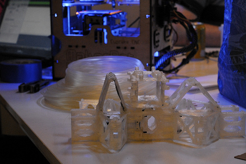 Saturdays are Makerbot Madness.   If you want to see the future of 3D printing, it's a good time to come down.      This week, Nick Burrows brought by his bot and his  Sarrus Linkage ,  It was the first time I've seen a real one, and although we have a ton of shop projects already,  I really want one now.    Smooth linear motion with no guide rods.   Pure awesome.   The  LearnMakeCupcake  crew and the  RHS TEC club  also showed up to work on their makerbots.  LMC is learning to build, tune and use their machine, and Ben is working furiously to build a mendel for as cheap as humanly possible.         Ben's  CupcakeStrap  is making some good progress, and he showed off his new extruder mod, based on a paxtruder, but with a gigantic stepper from a printer.   It's amazing what you can scrap together with a little ingenuity and time.  This 3D printer has cost somewhere around $300 so far, witth most of the money sunk into electronics.    Once it is up and running, they're going to build up a Mendel and scavenge the strap for the parts.  It doesn't have to be pretty (although I think it's awesome since it's made of so much scrap), it just has to work well enough to get them to the next step.      One thing they (or anyone looking to print cheaply) might take a look at is Polypropylene(PE).   Mark Ganter from Open3DP stopped by with a -massive- roll.   He just picked up 50lbs for $1.50/lb (shipped!).    We decided to take a closer look at it on the Shop Mendel because our  Wade Extruder  will extrude pretty much anything and if it jams, it's simple to fix. (Thanks Wade!)   PP prints best on Polyethylene (we used an Ikea cutting board).   Our first two prints were too hot and fast to produce a good result.   The filament bubbled and separated and had a finish like cottage cheese.  It didn't stop us though, and by the third print, we were getting a clean but warped part. (this is a mendel   circuit-board - spacer -m4_2off for those of you wondering).             All were solid enough to use, and dimensionally correct in hole and spacing. Other than the warp, which we can likely eliminate with heat, the last one didn't even look bad.  This stuff is strong, printable and dirt cheap.   We were wondering what it was originally produced for to make it so cheap, and I now think I know the magic google words.    11 gauge monofilament horse fencing   Be careful with those words though, there's a lot of horse and deer fencing out there that's polyamide 6. That means nylon, and as far as I know, that's untested grounds.    Definitely worth some experimentation at those prices, but a 1000ft spool of fail could also be a result.