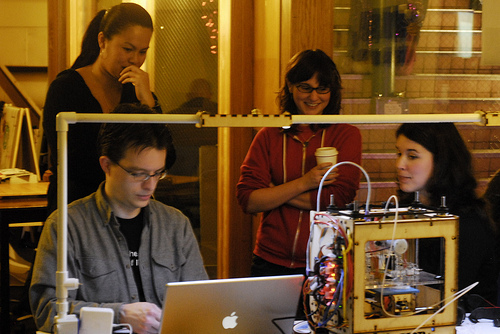 Darivanh Vlachos, Alexis Hope and Kate MacCorkle (from left to right above) came down to Metrix this evening to learn about MakerBots. This is not in itself noteworthy, especially since we're pretty much the only shop in the neighborhood with any. What was different about this visit was that Darivanh, Alexis and Kate are all part of the Human Centered Design and Engineering at UW. They're going to be making a MakerBot and documenting how they learn how to make and use it as their class project on how everyday, non-technical folks learn how to use technology. This is possibly the most meta and intellectual use of Metrix I have yet to write about. It's especially meta when I consider the fact that I am now documenting the documentation of their project…woo, recursion vertigo. Anyway, one more example of just how interesting and creative things can get when you put a bunch of tools in a basement open to the general public.