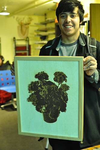 Fritz Rodriguez opted to swear at the file himself. For him, the lasercut was just the first step. He then photographed and printed the burned, woodsy version of this image of flowers, which is a royalty-free patent illustration.