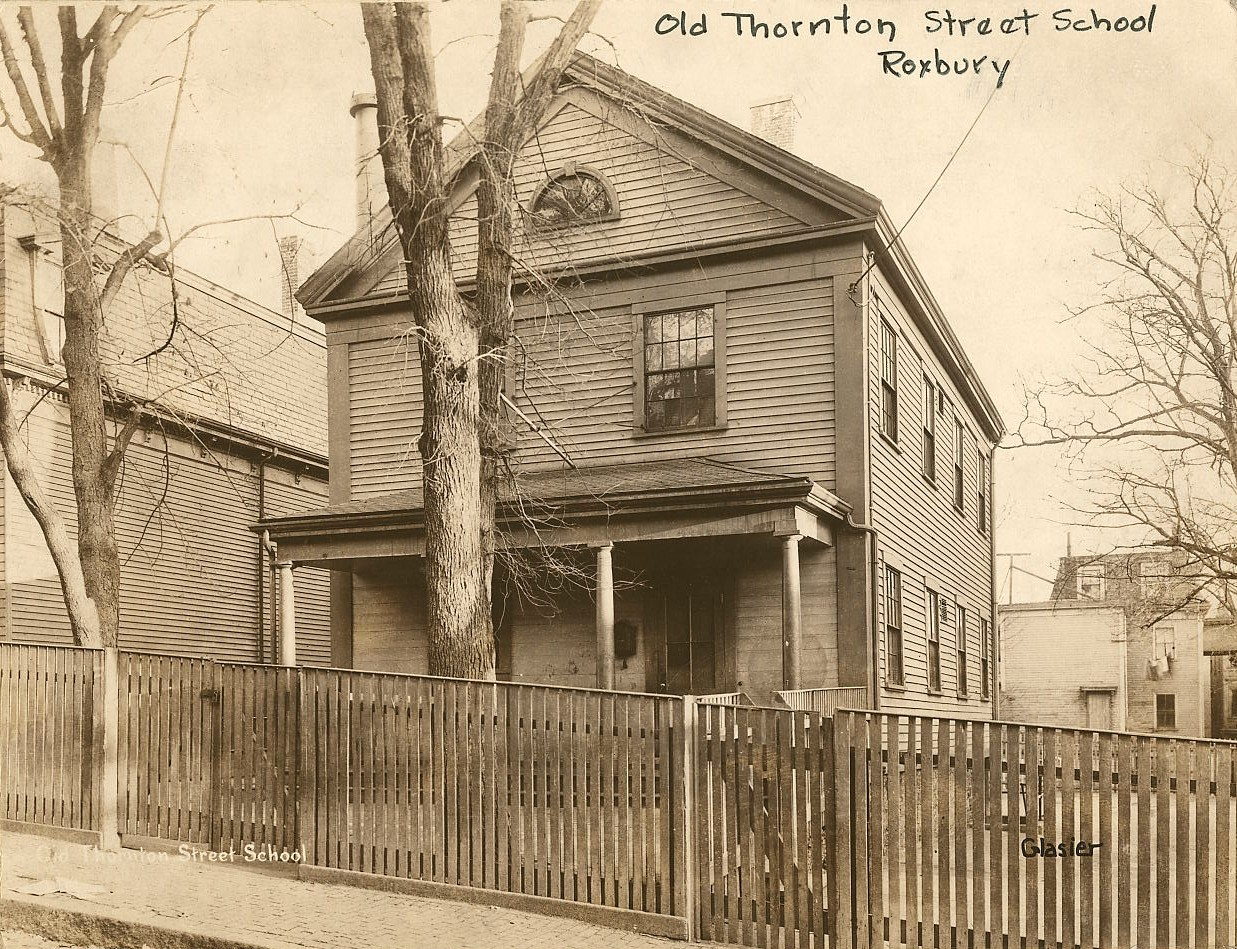 "BPL recently posted this pic of the ""old Thornton Street School.""  This is the first time I've heard of the school, but it's there on the 1852 map, when Thornton Street was Edinboro St.  The 1849 map doesn't show any buildings on that part of Edinboro St., but an 1893 Boston Schools document lists the building as having been built in 1847 and having two school rooms.  In 1893, the building was an elementary school in the Dillaway School District, which taught only girls (boys were in the Dudley District Schools).  It was located just south of the blue house on Thornton that is currently undergoing renovation. Here it is on the 1931 map at the ripe old age of 84, across the street from the newer, larger Abby May School built in 1893.  That's where the trail runs cold - I can't find any maps between 1931 and the relative present and don't know when it was destroyed.  If you've got any info about this mysteriously small yet long-lived school, please share! Coincidentally, I just ran across a description of the Abby May School from the 1893 City Archives in Google Books.  The Abby May school also gets a brief mention as ""the new primary schoolhouse"" in the other 1893 document I cited above. cityofbostonarchives: Old Thornton Street School, Roxbury, ca. 1920-1960,  School building photographs circa 1920-1960   (Collection # 0403.002) This work is free of known copyright restrictions.  Please attribute to City of Boston Archives. For more photos from this collection, click here"