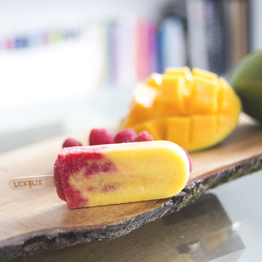 Our ice lollies are all handmade by the LICKALIX team with fresh fruit and are lactose, gluten, and dairy free like this Mango & Raspberry Swirl two-toned ice lolly!
