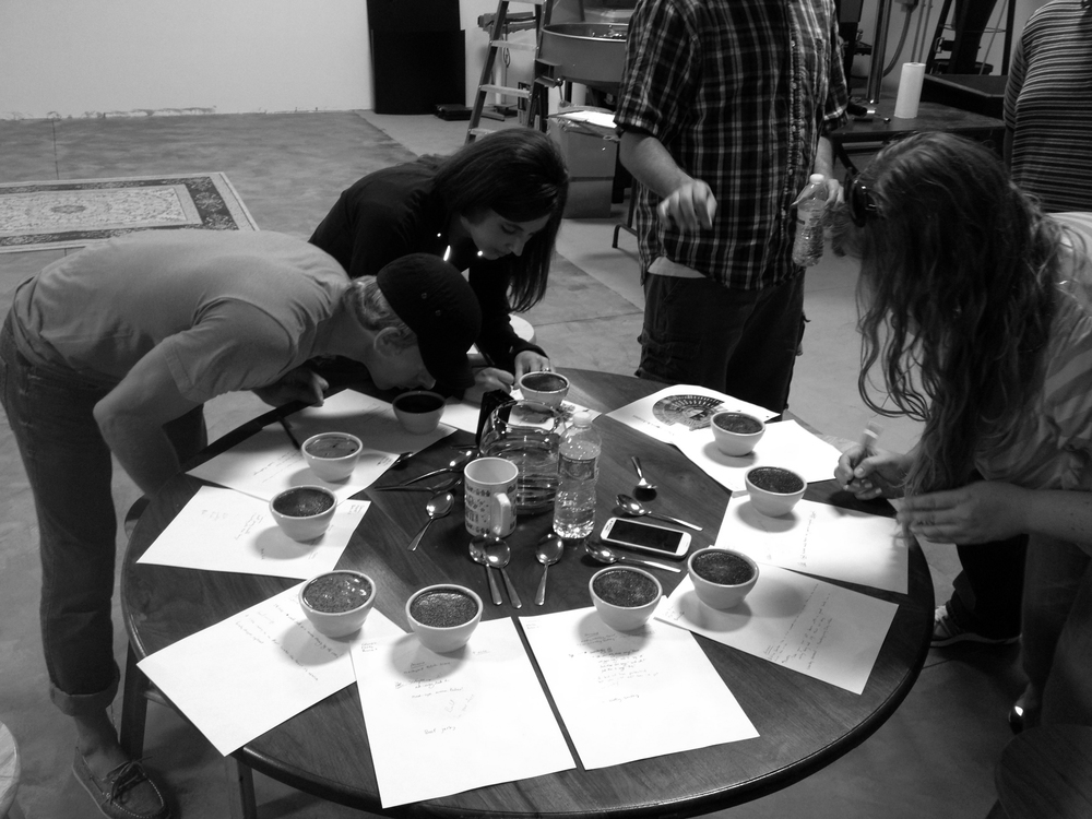"Friends cupping samples of coffees from all over the world, in our search for ""The Mighty Series,"" available at Dan's Supermarkets, online, and elsewhere!"