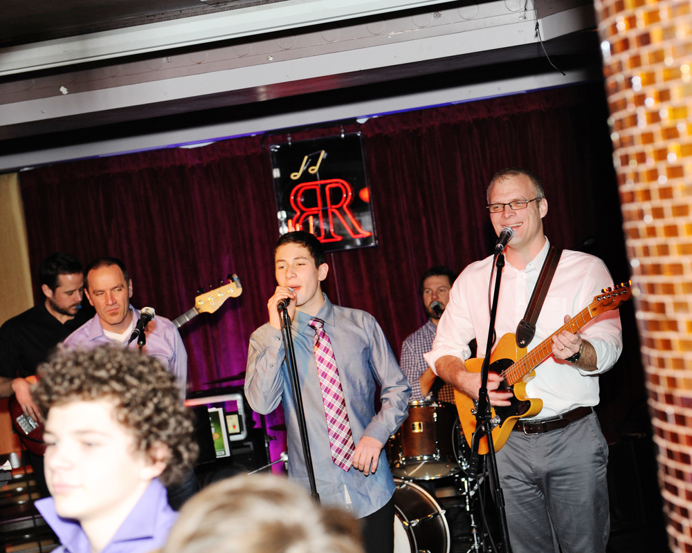 Bar Mitzvah'd lad rockin' with the band. Photo courtesy of g-gphoto.com.