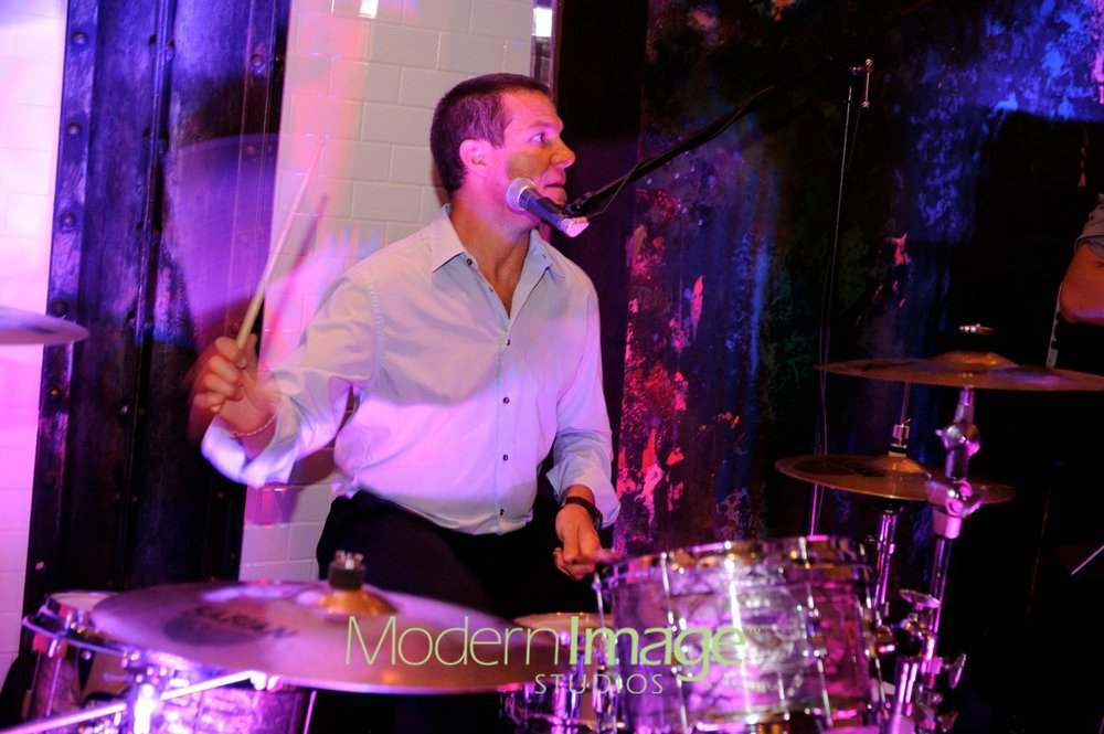 Scott pounding the drums and 'driving the party'.