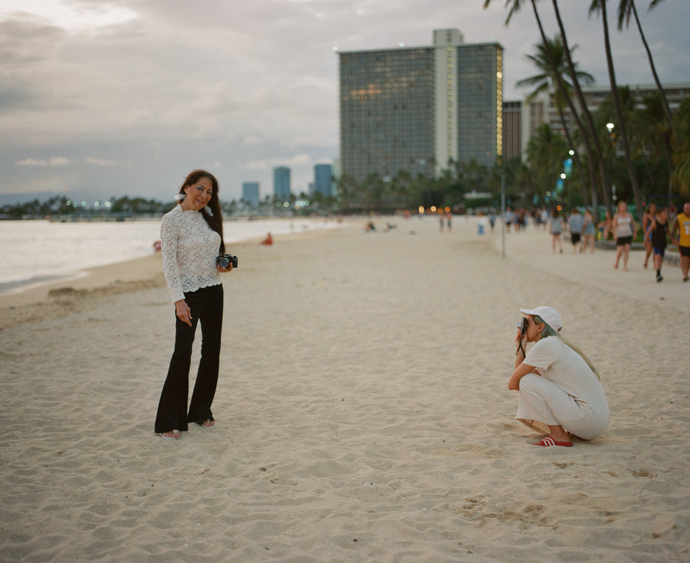 Mariah Ernst photographing Shirley Rogers in Waikiki by Gillian Garcia (https://gilliangarcia.us/)