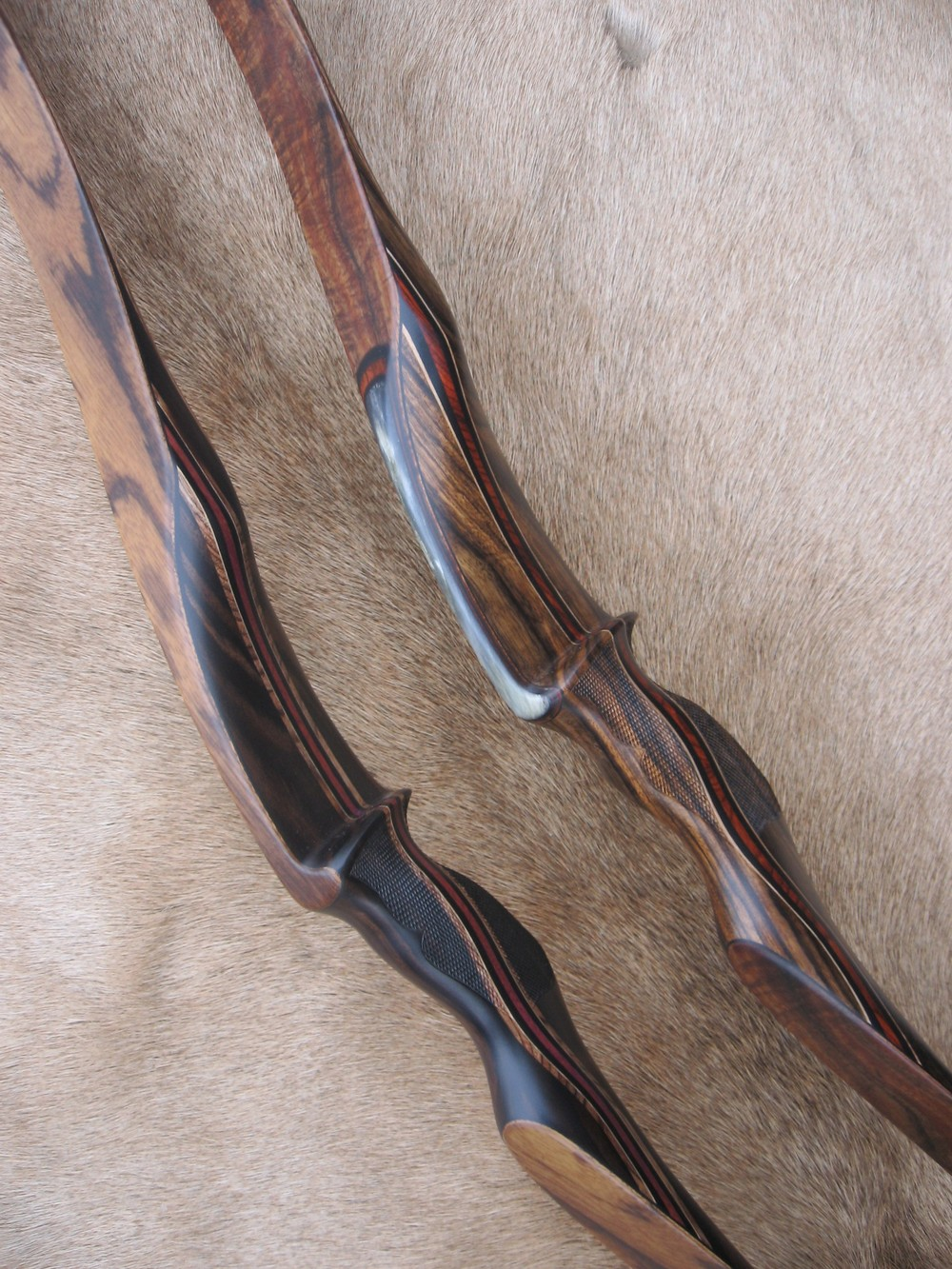 L to R - Macassar Ebony Riser w/ zebrawood limbs,  Shedua Riser with koa limbs.
