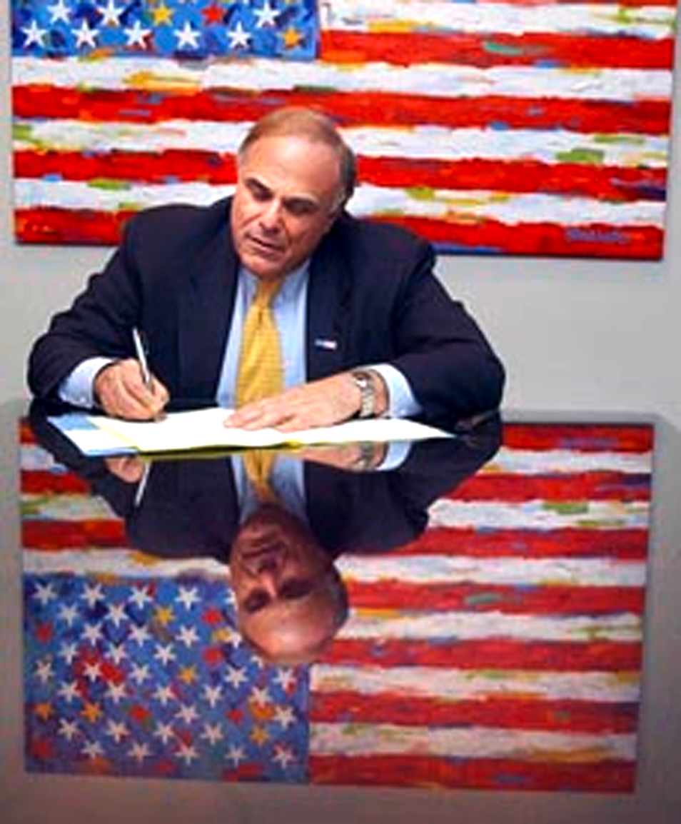 Gov. Rendell signs the budget in front of his STANGO flag