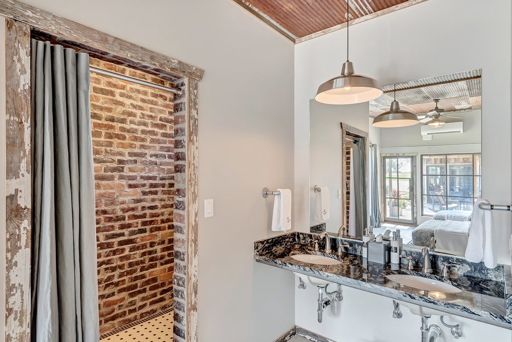 Brick Showers and Granite Vanities