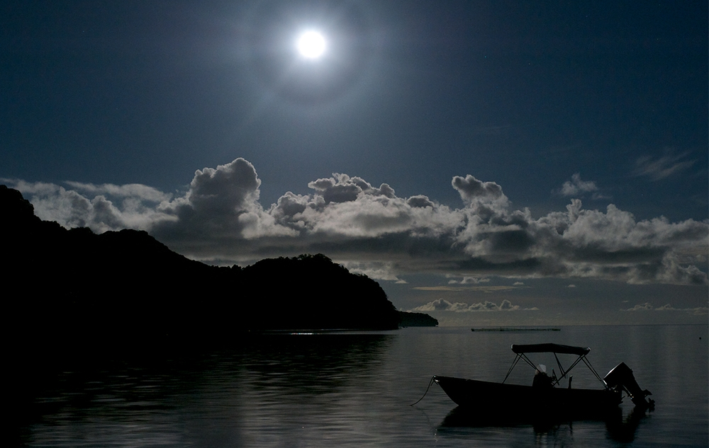 A 22° halo is an optical phenomenon forming a circle with a radius of 22° around the Sun or the Moon as seen here around a full moon in Palau.